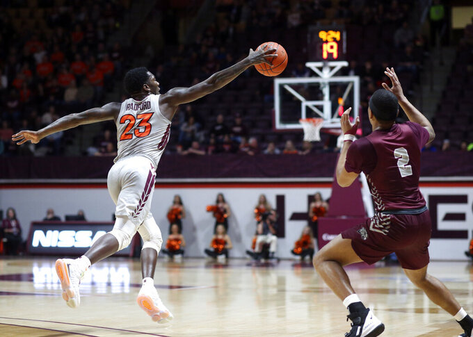 Virginia Tech's Tyrece Radford (23) intercepts a pass intended for Maryland-Eastern Shore's Ty Gibson (2) in the first half of an NCAA college basketball game in Blacksburg, Va., Sunday, Dec. 29 2019. Radford converted the steal for a basket on the play. (Matt Gentry/The Roanoke Times via AP)