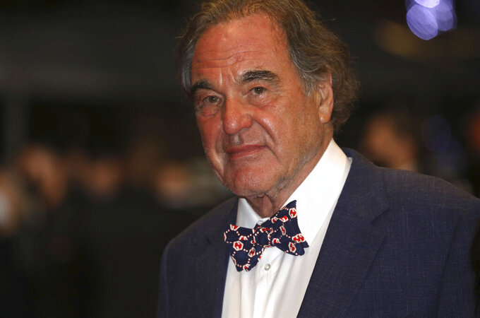 Oliver Stone poses for photographers upon arrival at the premiere of the film 'Flag Day' at the 74th international film festival, Cannes, southern France, Saturday, July 10, 2021. (Photo by Vianney Le Caer/Invision/AP)