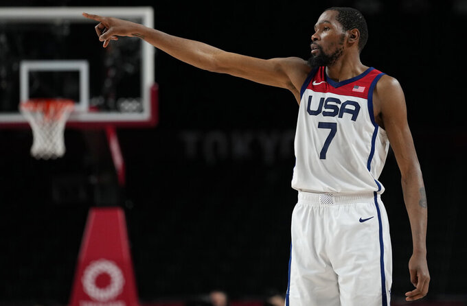 United States's Kevin Durant (7) gestures during men's basketball semifinal game against Australia at the 2020 Summer Olympics, Thursday, Aug. 5, 2021, in Saitama, Japan. (AP Photo/Eric Gay)