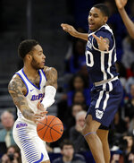 DePaul guard Devin Gage, left, passes against Butler guard/forward Henry Baddley during the first half of an NCAA college basketball game Wednesday, Jan. 16, 2019, in Chicago. (AP Photo/Nam Y. Huh)