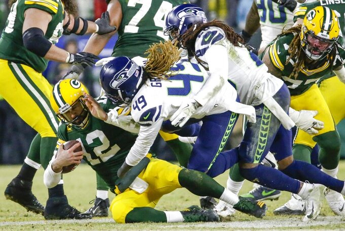 Seattle Seahawks' Shaquem Griffin and Shaquill Griffin sack Green Bay Packers quarterback Aaron Rodgers during the second half of an NFL divisional playoff football game Sunday, Jan. 12, 2020, in Green Bay, Wis. (AP Photo/Mike Roemer)