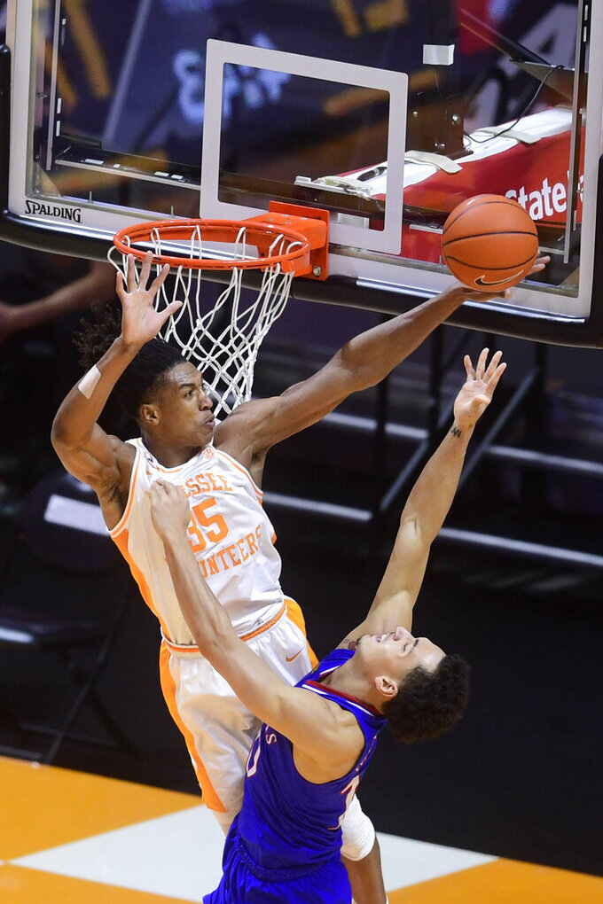Tennessee guard/forward Yves Pons (35) blocks a shot attempt by Kansas forward Jalen Wilson (10) during an NCAA college basketball game in Knoxville, Tenn., Saturday, Jan. 30, 2021. (Caitie McMekin/Knoxville News Sentinel via AP, Pool)