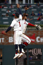 Atlanta Braves second baseman Ozzie Albies (1) and center fielder Ronald Acuna Jr. (13) celebrate after the Braves defeated the Washington Nationals 4-2 a baseball game Thursday, Sept. 5, 2019, in Atlanta. (AP Photo/John Bazemore)