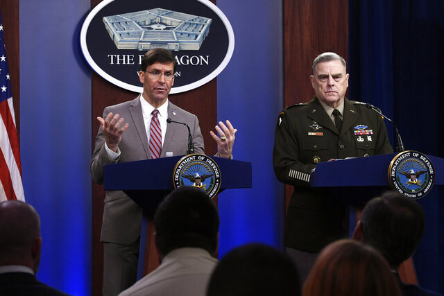 FILE - In this Monday, March 2, 2020 file photo, U.S. Defense Secretary Mark Esper, left, speaks  during a briefing with the Chairman of the Joint Chiefs of Staff Army Gen. Mark Milley, at the Pentagon in Washington. The U.S. military said Wednesday, March 4, 2020, that it has conducted an airstrike against Taliban forces in southern Afghanistan, only days after American and Taliban officials signed an ambitious peace deal in Doha, Qatar. A U.S. military spokesman said in a tweet Wednesday that it was the first U.S. strike against the militant group in 11 days. (AP Photo/Susan Walsh, File)
