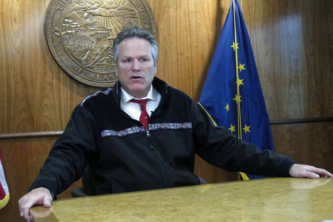 Alaska Gov. Mike Dunleavy speaks with reporters during a press briefing on Tuesday, Sept. 14, 2021, in Juneau, Alaska. Tuesday marked the last day of the third special session of the year. (AP Photo/Becky Bohrer)
