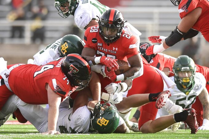 Texas Tech running back Tahj Brooks (28) is brought down on a run against Baylor during an NCAA college football game in Lubbock, Texas, Saturday, Nov. 14, 2020. (AP Photo/Justin Rex)