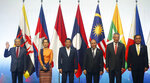 ASEAN Leaders pose for a group photo during the opening ceremony for the 33rd ASEAN Summit and Related Summits Tuesday, Nov. 13, 2018, in Singapore. From left, Prime Minister Mahathir Mohamad of Malaysia, Myanmar Leader Aung San Suu Kyi, President Rodrigo Duterte of The Philippines, Prime Minister Nguyen Xuan Phuc of Vietnam, Prime Minister Lee Hsien Loong of Singapore and Prime Minister Prayuth Chan-ocha of Thailand. (AP Photo/Bullit Marquez)