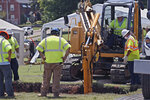 A backhoe digs deeper into the excavation site as work continues on an excavation of a potential unmarked mass grave from the 1921 Tulsa Race Massacre, at Oaklawn Cemetery in Tulsa, Okla., Tuesday, July 14, 2020.  On May 31 and June 1 in 1921, white residents looted and burned Tulsa's black Greenwood district, killing as many as 300 people with many believed buried in mass graves. (AP Photo/Sue Ogrocki)