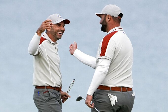 Team Europe's Sergio Garcia and Team Europe's Jon Rahm celebrate on the 16th hole during a four-ball match the Ryder Cup at the Whistling Straits Golf Course Saturday, Sept. 25, 2021, in Sheboygan, Wis. (AP Photo/Jeff Roberson)