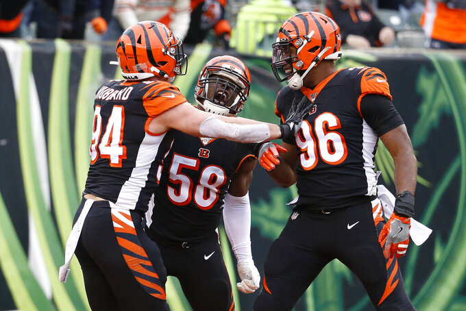 Cincinnati Bengals defensive end Carl Lawson (58) reacts alongside defensive end Carlos Dunlap (96) and defensive end Sam Hubbard (94) after sacking New York Jets quarterback Sam Darnold during the first half of an NFL football game, Sunday, Dec. 1, 2019, in Cincinnati. (AP Photo/Frank Victores)