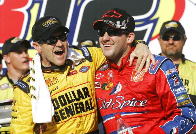 "FILE - In this April 28, 2007, file photo, Bobby Labonte, left, and Tony Stewart, right, celebrate Labonte's win in the NASCAR Busch Series' Aaron's 312 auto race at Talladega Superspeedway in Talladega, Ala. Joe Gibbs, already an NFL Hall of Famer, will be inducted into the NASCAR Hall of Fame alongside Tony Stewart and Bobby Labonte, two drivers who helped him build one of NASCAR's top teams while giving ""Coach Joe"" three of the organization's five titles. (AP Photo/Rob Carr, File)"