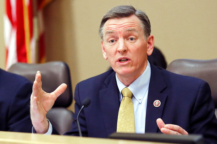 FILE - In this Dec. 2013, file photo, U.S. Rep. Paul Gosar, R-Ariz., speaks during a Congressional field hearing on the Affordable Care Act in Apache Junction, Ariz. Gosar appears to be signaling support for a conspiracy theory that Jeffrey Epstein did not kill himself while awaiting trial on sex trafficking charges. The Republican congressman sent 23 tweets Wednesday, Nov. 13, 2019 about impeachment hearings. The first letter of each tweet spelled out would read,