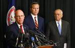 Dean of Eastern Virginia Medical School of Medicine, Richard Homan, left, speaks to the media as attorney for McGuire Woods law firm, Ben Hatch, center, and McGuire Woods partner, Richard Cullen, right, listen during a news conference on a report announcing the results of an investigation into a blackface photo that appeared on the yearbook page of Virginia Gov. Ralph Northam from his Eastern Virginia Medical School yearbook in Norfolk, Va., Wednesday, May 22, 2019. (AP Photo/Steve Helber)