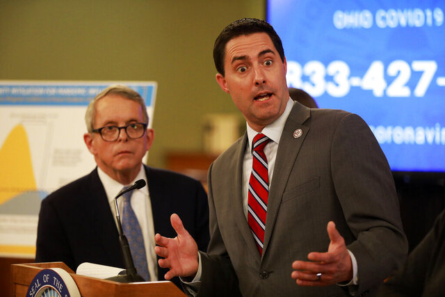 File-Moments after announcing the possible extension of Ohio voting until June 2, Ohio Secretary of State Frank LaRose answers a reporter's question at a coronavirus news conference Saturday, March 14, 2020, at the Ohio Statehouse. Congress' failure so far to pass another round of coronavirus aid leaves state and local officials on their own to deal with the soaring costs of holding a presidential election amid a deadly pandemic.  LaRose has said he would seek approval to pay postage for absentee ballot applications and returned ballots if he had more money. (Doral Chenoweth/The Columbus Dispatch via AP, File)
