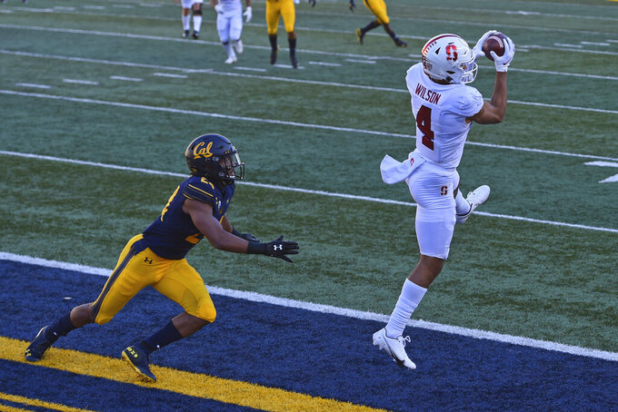 Stanford's Michael Wilson (4) makes a touchdown reception in front of California's Camryn Bynum (24) during the second quarter of an NCAA college football game Friday, Nov. 27, 2020, in Berkeley, Calif. (Jose Carlos Fajardo/Bay Area News Group via AP)