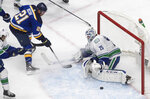 Vancouver Canucks goalie Jacob Markstrom (25) stops St. Louis Blues' Tyler Bozak (21) during the second period in Game 1 of an NHL hockey Stanley Cup first-round playoff series, Wednesday, Aug. 12, 2020, in Edmonton, Alberta. (Jason Franson/The Canadian Press via AP)