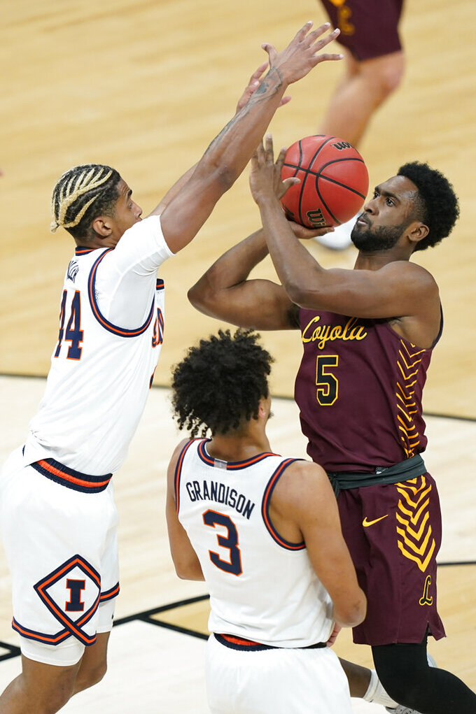 Loyola of Chicago's Keith Clemons (5) shoots against Illinois' Adam Miller (44) and Jacob Grandison (3) during the first half of a college basketball game in the second round of the NCAA tournament at Bankers Life Fieldhouse in Indianapolis Sunday, March 21, 2021. (AP Photo/Mark Humphrey)