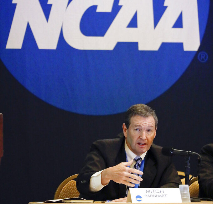 "FILE - In this Jan. 19, 2017, file photo, Mitch Barnhart, athletic director at Kentucky, takes part in a panel discussion at the NCAA Convention in Nashville, Tenn. There is no need to worry about geography in this year's NCAA Tournament. Get ready for plenty of talk about the so-called ""S curve"" instead. And do not worry — it's not that complicated. (AP Photo/Mark Humphrey, File)"