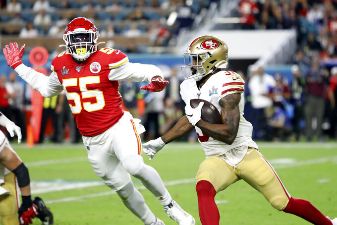 San Francisco 49ers Raheem Mostert runs with the ball during the Super Bowl LIV football game against the Kansas City Chiefs, Sunday, Feb. 2, 2020 in Miami. (AP Photo/Gregory Payan)