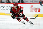 FILE - In this Feb. 17, 2020, file photo, Arizona Coyotes left wing Taylor Hall (91) is shown during the first period of an NHL hockey game against the New York Islanders, in Glendale, Ariz. The NHL is embarking on a free agent period like never before in hockey history. Defensemen Alex Pietrangelo and Torey Krug and winger Taylor Hall headline a talented free agent class. (AP Photo/Rick Scuteri, File)