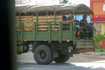 FILE - In this May 23, 2021, file photo, military troops and police go on patrol at Kayah state, eastern Myanmar. At least one-quarter of the people in Myanmar's smallest state have been forced to flee their homes because of combat with the military junta that seized power in February, raising fears of a possible humanitarian tragedy including thousands of civilian deaths, a U.N. expert said Wednesday, June 9.(AP Photo/File)
