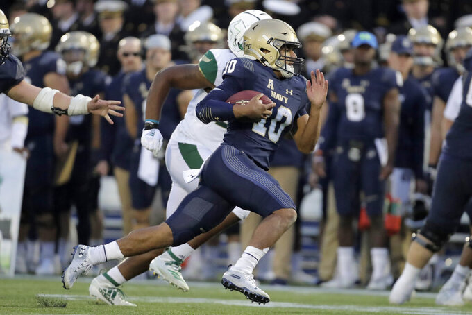 Navy quarterback Malcolm Perry (10) runs for a touchdown against South Florida during the second half of an NCAA college football game, Saturday, Oct. 19, 2019, in Annapolis. Navy won 35-3. (AP Photo/Julio Cortez)