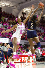 North Carolina State's DD Rogers (21) and Notre Dame's Jackie Young (5) battle for a rebound during the first half of an NCAA college basketball game in Raleigh, N.C., Monday, Feb. 18, 2019. (AP Photo/Ben McKeown)