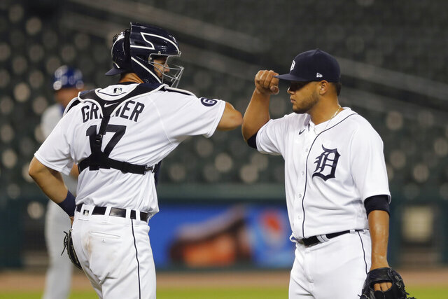 Detroit Tigers relief pitcher Joe Jimenez and catcher Grayson Greiner greet each other after the Tigers' 5-4 win over the Kansas City Royals in a baseball game, Wednesday, July 29, 2020, in Detroit. (AP Photo/Carlos Osorio)