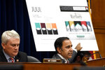 House Oversight and Government Reform subcommittee chair Rep. Raja Krishnamoorthi, D-Ill., right, speaks as he questions JUUL Labs co-founder and Chief Product Officer James Monsees during a subcommittee hearing on Capitol Hill in Washington, Thursday, July 25, 2019, on the youth nicotine epidemic. Subcommittee ranking member Rep. James Comer, R-Ky., is at left. (AP Photo/Susan Walsh)