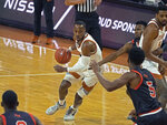 Texas guard Matt Coleman, III drives the ball during the first half of an NCAA college basketball game against Sam Houston State, Wednesday, Dec. 16, 2020, in Austin, Texas. (AP Photo/Michael Thomas)