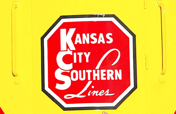 FILE - In this Nov. 5, 2004, file photo, the logo of Kansas City Southern is down on a restored 1954 Kansas City Southern passenger locomotive at Union Station in Kansas City, Mo. Kansas City Southern railroad is trying to keep its $33.6 billion merger with Canadian National on track by rejecting a competing $31 billion bid from rival Canadian Pacific earlier this week. Kansas City Southern said Thursday, Aug. 12, 2021, that its board unanimously decided to continue backing Canadian National's higher offer. .(Norman Ng/The Kansas City Star via AP, File)