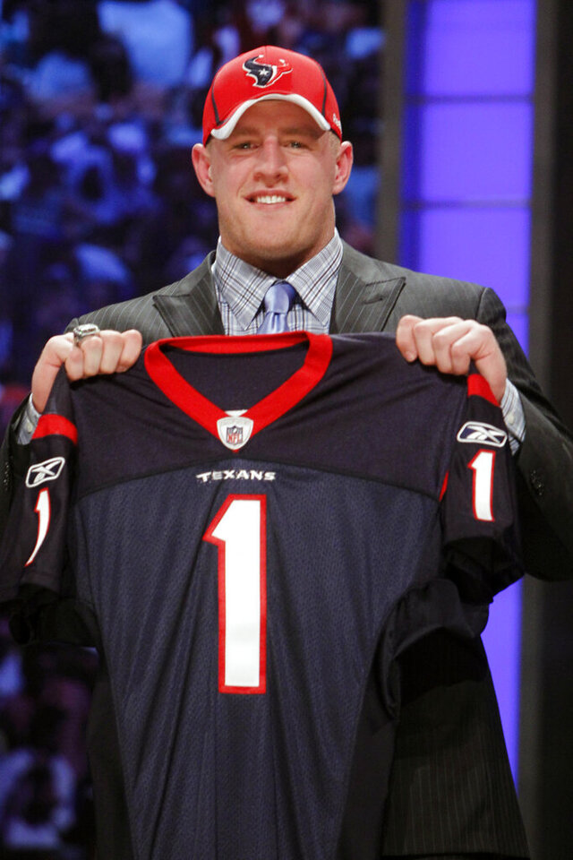 FILE - In this April 28, 2011, file photo, Wisconsin defensive end J.J. Watt holds up a jersey after he was selected as the 11th overall pick by the Houston Texans in the first round of the NFL football draft at Radio City Music Hall  in New York. He was booed by Texans fans when he was selected with the 11th overall pick in the 2011 draft. But it didn't take Watt long to win over the fan base and become the most beloved Texan of all time. (AP Photo/Jason DeCrow, File)