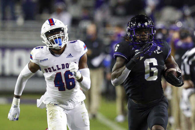 Louisiana Tech linebacker Ezekiel Barnett (46) pursues TCU running back Zach Evans (6) on a touchdown run in the third quarter during an NCAA college football game, Saturday, Dec. 12, 2020. (AP Photo/ Richard W. Rodriguez)
