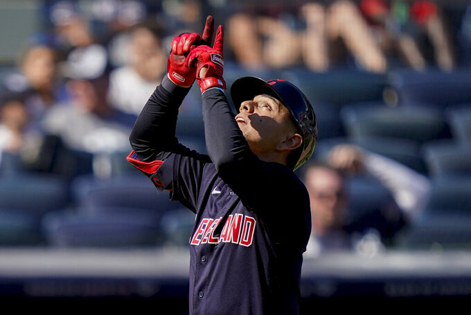 Cleveland Indians' Andres Gimenez reacts as he runs home after hitting a three-run home run off New York Yankees relief pitcher Albert Abreu in the fifth inning of a baseball game, Saturday, Sept. 18, 2021, in New York. (AP Photo/John Minchillo)