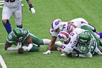 New York Jets' John Franklin-Myers (91), left, recovers the ball fumbled by Buffalo Bills quarterback Josh Allen (17) during the first half of an NFL football game, Sunday, Oct. 25, 2020, in East Rutherford, N.J. (AP Photo/John Minchillo)