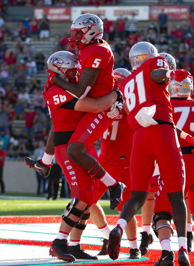 New Mexico tight end Kyle Jarvis (5) celebrates with teammates after scoring a touchdown against Houston Baptist in the first half of an NCAA college football game on Thursday, Sept. 2, 2021, in Albuquerque, N.M. (AP Photo/Andres Leighton)