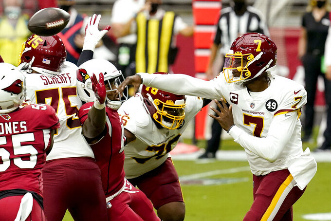 Washington Football Team quarterback Dwayne Haskins (7) throws under pressures against the Arizona Cardinals during the first half of an NFL football game, Sunday, Sept. 20, 2020, in Glendale, Ariz. (AP Photo/Ross D. Franklin)