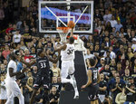 Central Florida forward Collin Smith (35) lays up the ball against Cincinnati center Nysier Brooks (33) and guard Jarron Cumberland (34) during the first half of an NCAA college basketball game, Thursday, March 7, 2019, in Orlando, Fla. (AP Photo/Willie J. Allen Jr.)