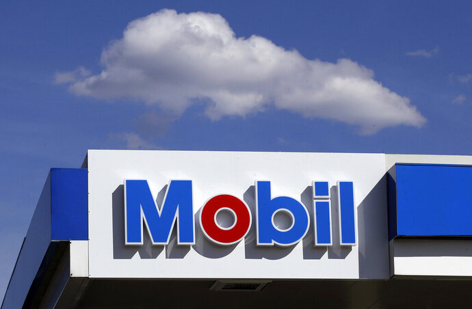 FILE - This April 24, 2017, photo shows signage at a Mobil gasoline station in Londonderry, N.H. Exxon Mobil Corp. reports financial results on Friday, April 26, 2019. (AP Photo/Charles Krupa, File)