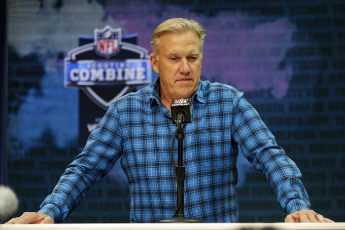 Denver Broncos president of football operations and general manager John Elway speaks during a press conference at the NFL football scouting combine in Indianapolis, Tuesday, Feb. 25, 2020. (AP Photo/Michael Conroy)