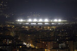 The San Paolo Stadium is illuminated to honor soccer legend and former Napoli player Diego Armando Maradona, in Naples, Italy, Wednesday, Nov. 25, 2020. Diego Maradona has died. The Argentine soccer great was among the best players ever and who led his country to the 1986 World Cup title before later struggling with cocaine use and obesity. He was 60. (AP Photo/Salvatore Laporta)