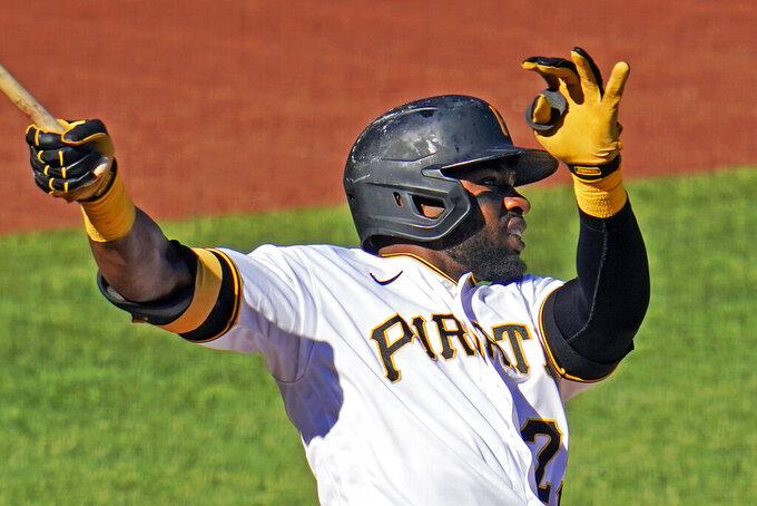 Pittsburgh Pirates' Gregory Polanco drives in a run with a ground rule double to left center field off Cincinnati Reds starting pitcher Luis Castillo during the third inning of the first of two baseball games in Pittsburgh, Friday, Sept. 4, 2020. (AP Photo/Gene J. Puskar)