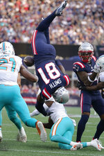 New England Patriots tight end Jonnu Smith (81) is upended by Miami Dolphins cornerback Justin Coleman during the first half of an NFL football game, Sunday, Sept. 12, 2021, in Foxborough, Mass. (AP Photo/Steven Senne)