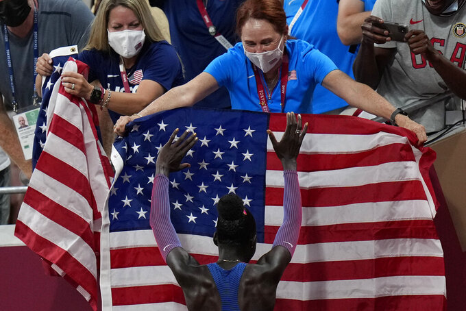 Athing Mu, of United States, celebrates after winning the final of the women's 800-meters at the 2020 Summer Olympics, Tuesday, Aug. 3, 2021, in Tokyo. (AP Photo/Petr David Josek)