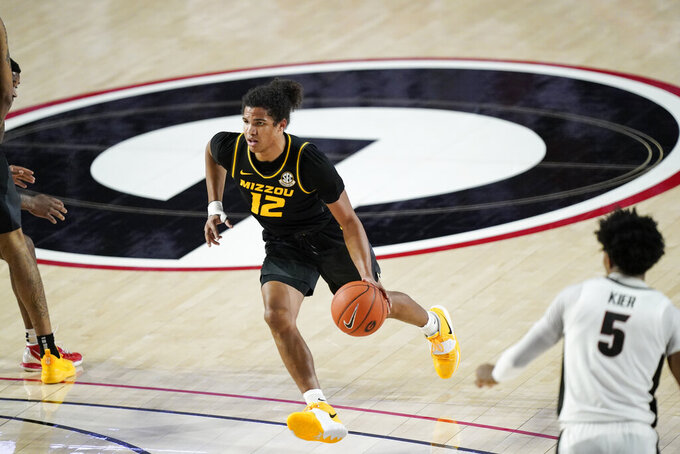 Missouri guard Dru Smith (12) drives during the first half of the team's NCAA college basketball game against Georgia on Tuesday, Feb. 16, 2021, in Athens, Ga. (AP Photo/Brynn Anderson)