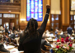 Rep. Park Cannon, D-Atlanta, raises her fist in protest as a SB 115 passes the House on the final day of the 2021 Legislative session Wednesday, March 31, 2021 in Atlanta. (Ben Gray/Atlanta Journal-Constitution via AP)