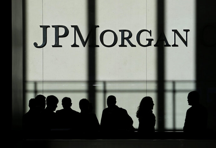 FILE - In this Oct. 21, 2013, file photo, the JPMorgan Chase logo is displayed at their headquarters in New York. Banking giant JPMorgan Chase said that its fourth-quarter profits jumped 21% from a year earlier, as the bank's trading desks had a blowout quarter. A sharp increase in JPMorgan's trading business made up for declining interest rates, which impacted other parts of the bank. (AP Photo/Seth Wenig, File)