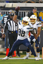 Los Angeles Chargers tight end Virgil Green (88) spikes the ball after scoring a touchdown against the Jacksonville Jaguars during the second half of an NFL football game, Sunday, Dec. 8, 2019, in Jacksonville, Fla. (AP Photo/Stephen B. Morton)