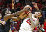 Washington forward Noah Dickerson, left, and Utah forward Timmy Allen (20) vie for a rebound during the second half of an NCAA college basketball game Thursday, Jan. 10, 2019, in Salt Lake City. (AP Photo/Rick Bowmer)