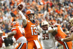 Syracuse's Tommy DeVito passes under pressure from Boston College during the second quarter of an NCAA college football game in Syracuse, N.Y., Saturday, Nov. 2, 2019. (AP Photo/Nick Lisi)
